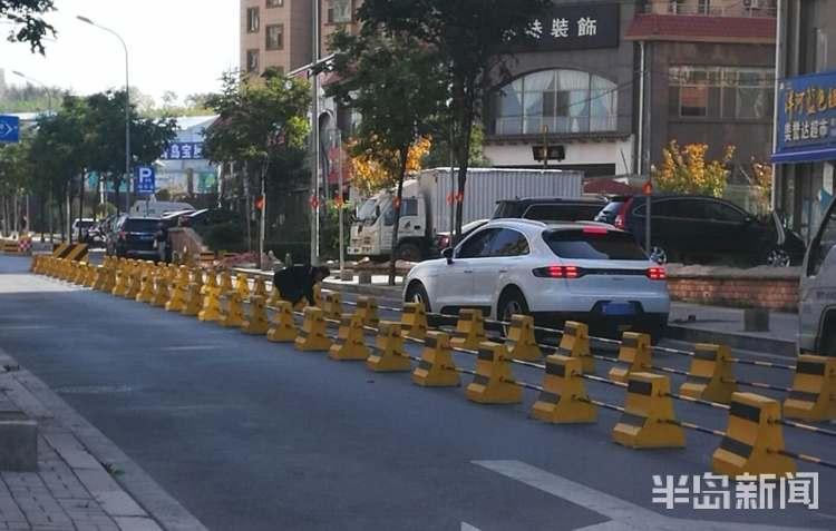 马路上私设围栏通车不便  青岛交警:正落实设置者,将移除